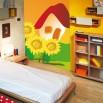 Fototapeta bajkowy domek i słoneczniki dla dzieci